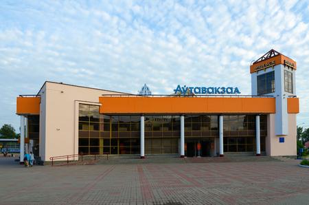 bus station: VITEBSK, BELARUS - JULY 13, 2016: Unidentified people walk past building of bus station on landing platform, Vitebsk, Belarus
