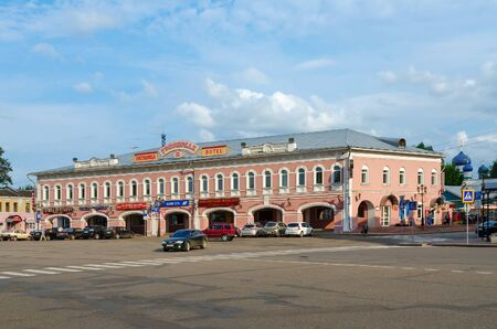 uglich russia: UGLICH, RUSSIA - JULY 19, 2016: Unidentified people are in historic center of town on Uspenskaya square near hotel Uspenskaya (former building of trade rows), Uglich, Russia