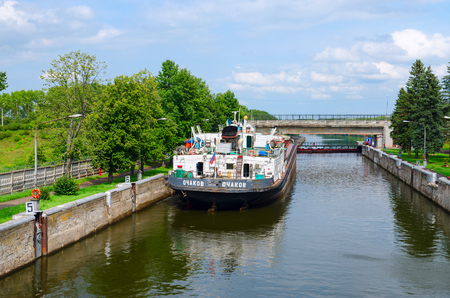 superstructure: UGLICH, RUSSIA - JULY 19, 2016: Dry cargo ship Ochakov (type Sixth Five-Year Plan, project 576) in ship lock of Uglich hydroelectric power station, Russia