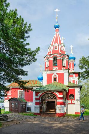 uglich russia: UGLICH, RUSSIA - JULY 19, 2016: Unknown woman goes near Church of Tsarevich Dmitry on Blood, Uglich, Russia