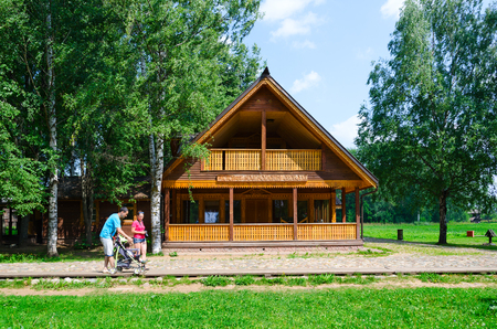 KOSTROMA, RUSSIA - JULY 20, 2016: Kostroma Architectural-Ethnographic and Landscape Museum-Reserve Kostromskaya Sloboda. Unidentified people go along road near restaurant Kostromskaya Sloboda Editorial