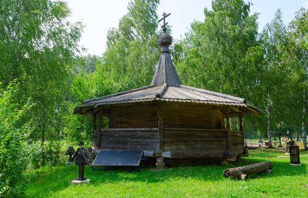 octahedral: KOSTROMA, RUSSIA - JULY 20, 2016: Unidentified people visit Kostroma Architectural-Ethnographic and Landscape Museum-Reserve Kostromskaya Sloboda. Chapel from village Bolshoe Tokarevo of Soligalichsky District of Kostroma region