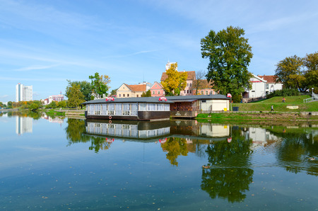 svisloch: MINSK, BELARUS - OCTOBER 1, 2016: View of Trinity Suburb and cafe Barge on Svisloch River, Minsk, Belarus Editorial