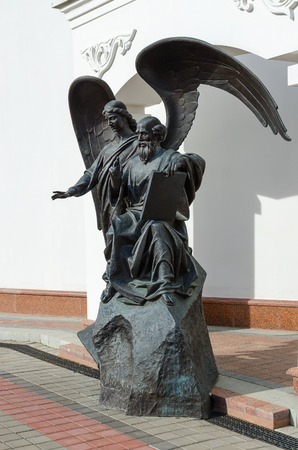 theologian: MINSK, BELARUS - OCTOBER 1, 2016: Sculptural composition (monument to John the Theologian) at church of St. Cyril of Turov, Minsk, Belarus