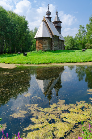 octahedral: KOSTROMA, RUSSIA - JULY 20, 2016: Kostroma Architectural-Ethnographic and Landscape Museum-Reserve Kostromskaya Sloboda. Church of Savior from village Fominskoe. Rural landscape Editorial