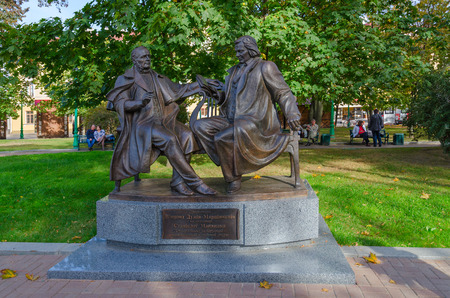 MINSK, BELARUS - OCTOBER 1, 2016: Unidentified people are relaxing in park near monument to playwright Vincent Dunin-Marcinkevich and composer Stanislaw Moniuszko (founders of Belorussian national classical opera)