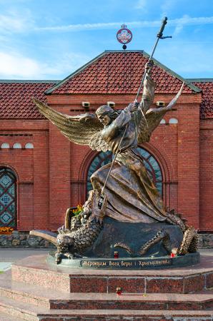 MINSK, BELARUS - OCTOBER 1, 2016: Sculpture of Archangel Michael, striking winged serpent, near Catholic Church of Saints Simon and Helena, Minsk, Belarus