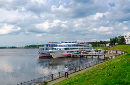 uglich russia: UGLICH, RUSSIA - JULY 19, 2016: Cruise Ships Georgy Zhukov, Alexandre Benois on river quay in Uglich. Unidentified people are strolling along promenade