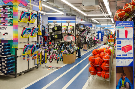 sporting goods: MOGILEV, BELARUS - SEPTEMBER 28, 2016: Unidentified people choose items for outdoor activities in sporting goods store Sportmaster, Mogilev, Belarus