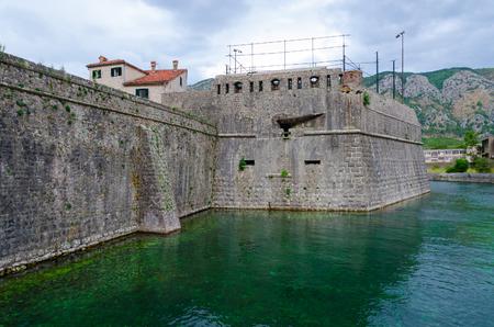 impregnable: Fortress wall of bastion Bembo (1540) near river Shkurda, Old town of Kotor, Montenegro Stock Photo