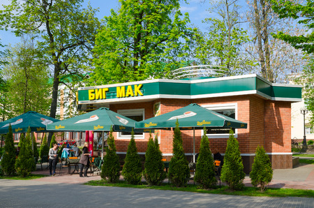 GOMEL, BELARUS - MAY 1, 2016: Unidentified people are resting outdoors in mini-cafe Big Mac in square named after A.A. Gromyko (former Pionersky park), Gomel, Belarus