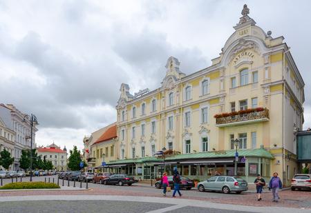 prestigious: VILNIUS, LITHUANIA - JULY 10, 2015: Unidentified people are walking on street near Radisson Blu Royal Astorija Hotel 5 * in Old town, Vilnius, Lithuania