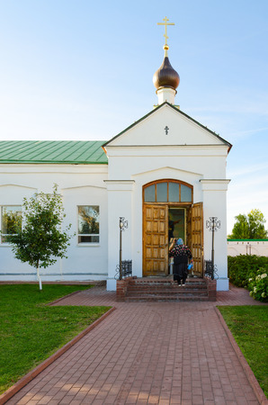 MUROM, RUSSIA - AUGUST 23, 2015: Unknown woman enters to Chapel in honor of Icon of Mother of God in Spaso-Preobrazhensky male Monastery, Murom, Russia Editorial