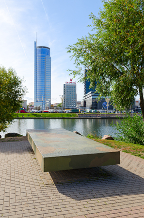 svisloch: MINSK, BELARUS - OCTOBER 1, 2016: Table memory on Island of Tears. On background - DoubleTree by Hilton Hotel Minsk and business center Royal Plaza on waterfront of river Svisloch