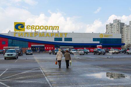 GOMEL, BELARUS - APRIL 14, 2016: Unidentified people go to supermarket Euroopt on Street Khatayevich, Gomel, Belarus