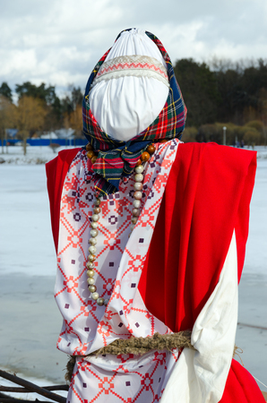 Shrovetide doll in colorful costume outdoors Stock Photo