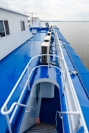 Ladder leading to captains cabin of cruise river motor ship. Ship is moving along Uglich reservoir Stock Photo