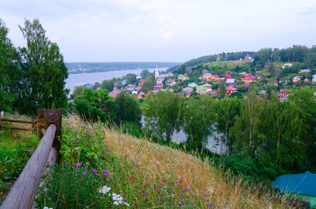 View from above on quiet provincial town of Ples and Volga River in summer twilight, Russia Stock Photo