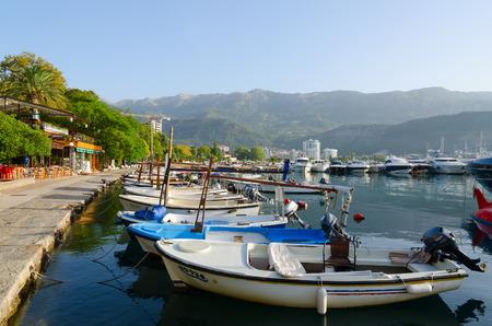 BUDVA, MONTENEGRO - SEPTEMBER 18, 2015: Pleasure boats and yachts at pier on waterfront of resort of Budva, Montenegro