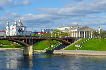 VITEBSK, BELARUS - MAY 16, 2017: Beautiful view of Western Dvina River, Holy Dormition Cathedral and National Academic Drama Theater named after Yakub Kolas, Vitebsk, Belarus