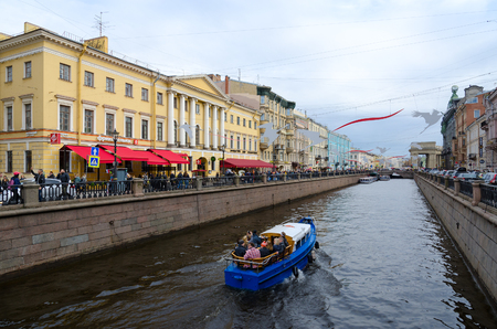SAINT PETERSBURG, RUSSIA - MAY 1, 2017: Unknown tourists are on sightseeing boat on Griboyedov Canal, St. Petersburg, Russia Editorial