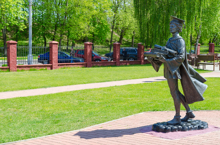 collegium: POLOTSK, BELARUS - MAY 19, 2017: Monument to Polotsk student on territory of former Jesuit collegium (now - Polotsk State University). Medieval scholar carries books and manuscript with seal Editorial