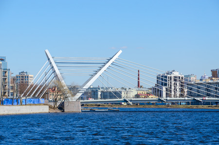 pedestrian bridges: SAINT PETERSBURG, RUSSIA - MAY 2, 2017: Lazarevsky cable-stayed bridge across Malaya Nevka River, St. Petersburg, Russia