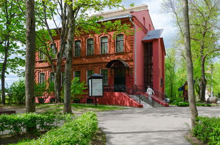 chagall: VITEBSK, BELARUS - MAY 21, 2017: Unknown woman goes to Art Center of Marc Chagall (exhibition of original graphic works by Marc Chagall), Vitebsk, Belarus