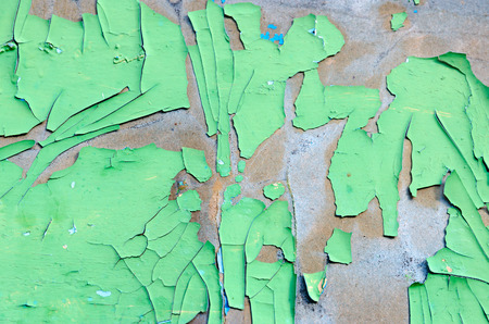 Texture of cracked green paint on old surface, background Stock Photo