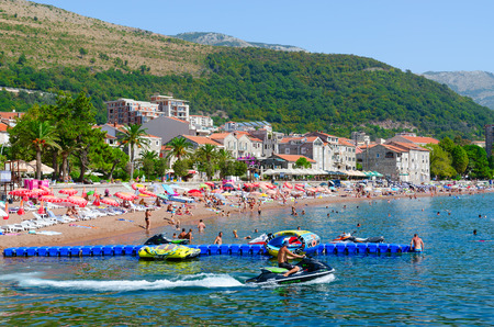 PETROVAC, MONTENEGRO - SEPTEMBER 19, 2015: Unknown people rest on beach of popular resort town of Petrovac, Montenegro