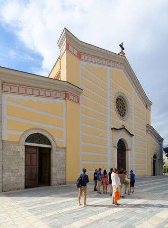 SHKODER, ALBANIA - SEPTEMBER 6, 2017: Group of unknown tourists is located near Cathedral of St. Stephen (Franciscan Church of Ruga-Ndre-Mdzheda), Shkoder, Albania