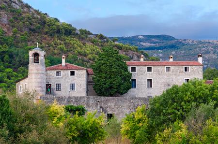 BUDVA, MONTENEGRO - SEPTEMBER 7, 2017: Unknown man is on territory of monastery Podmaine, or Podostrog, Budva, Montenegro Editorial