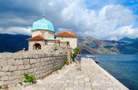PERAST, MONTENEGRO - SEPTEMBER 10, 2017: Unknown tourists visit Island of Virgin on reef (Gospa od Skrpela Island), Bay of Kotor, Montenegro Editorial