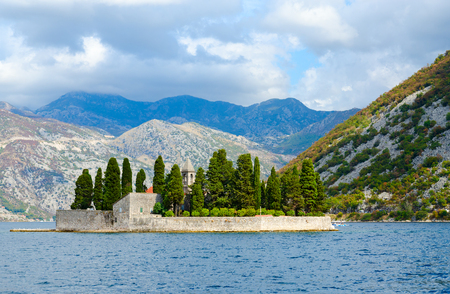 Beautiful view of St. George Island (Island of Dead) on background of mountains, Bay of Kotor, Montenegro