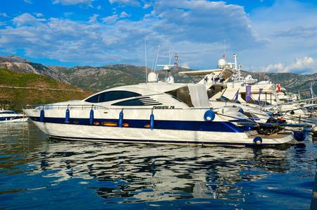 BUDVA, MONTENEGRO - SEPTEMBER 5, 2017: Pleasure yachts at pier on waterfront of popular resort of Budva, Montenegro Editorial