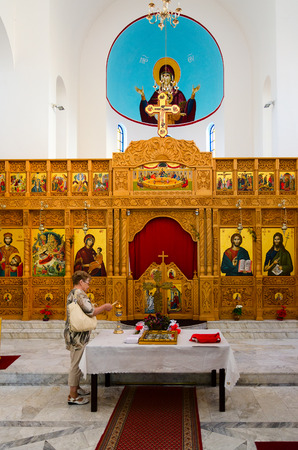 SHKODER, ALBANIA - SEPTEMBER 6, 2017: Unknown woman visits Orthodox Church (Church of Nativity of Christ), Shkoder, Albania