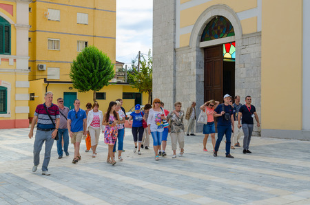 SHKODER, ALBANIA - SEPTEMBER 6, 2017: Group of unknown tourists are near St. Stephens Cathedral, Shkoder, Albania