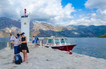 PERAST, MONTENEGRO - SEPTEMBER 10, 2017: Unknown tourists visit Island of Virgin on reef (Gospa od Skrpela Island), Montenegro Editorial