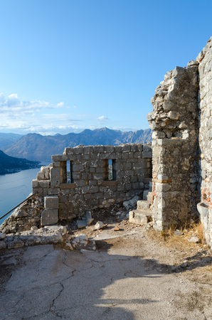 Ruins of ancient fortress of St. John (Illyrian Fort) over city of Kotor and Bay of Kotor, Montenegro