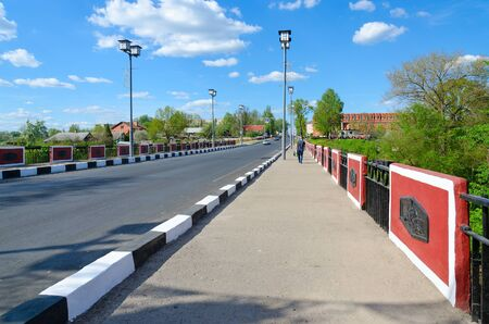 POLOTSK, BELARUS - MAY 19, 2017: Red Bridge over River Polota (monument of war of 1812 on Polotchyna), Polotsk, Belarus. Unknown people walking down street