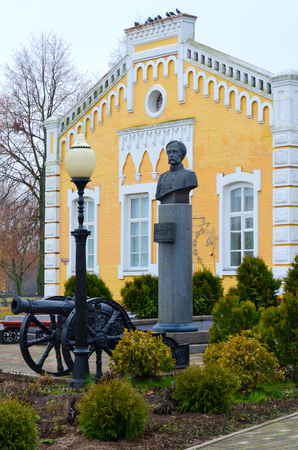 DOBRUSH, BELARUS - NOVEMBER 20, 2017: Monument to Prince Fyodor Ivanovich Paskevich near building of Dobrush regional museum of local lore (monument of architecture of early 20th century), Belarus Editorial