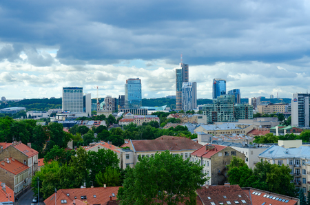 VILNIUS, LITHUANIA - JULY 10, 2015: View from observation platform of bell tower on City high-rise buildings and red tiled roofs in Old Town, Vilnius, Lithuania Editorial