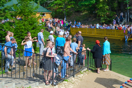 TSYGANOVKA, RUSSIA - AUGUST 22, 2015: Unknown pilgrims are on holy spring of Monk Seraphim of Sarov near village of Tsyganovka, Russia Editorial