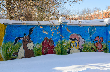 GOMEL, BELARUS - MARCH 5, 2018: Graffiti depicting heroes of cartoon Winnie the Pooh on concrete fence in city courtyard, Gomel, Belarus Editorial