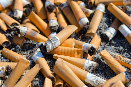 Cigarette butts close-up, background