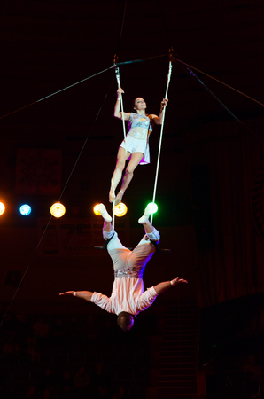 GOMEL, BELARUS - MARCH 23, 2018: Tour of Moscow State Circus named after Nikulin. Duet on trapeze (air gymnasts Victoria and Alexei Artemyev)