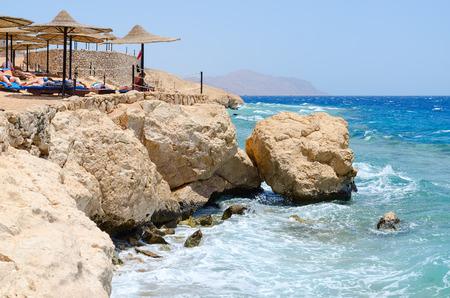 SHARM EL SHEIKH, EGYPT - MAY 8, 2018: Unknown people rest on beach of popular hotel Siva Sharm (ex. Savita Resort) 5 *, Sharm El Sheikh, Egypt