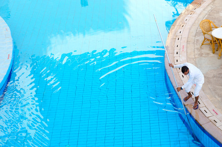 SHARM EL SHEIKH, EGYPT - MAY 11, 2018: Unknown employee of hotel Siva Sharm (ex Savita Resort) 5 * cleans pool, Sharm El Sheikh, Egypt Editorial