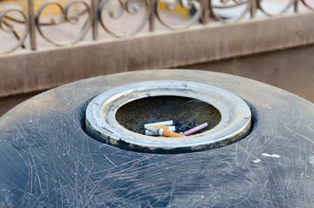 Cigarette butts in ashtray on city street, Sharm El , Egypt Banque d'images