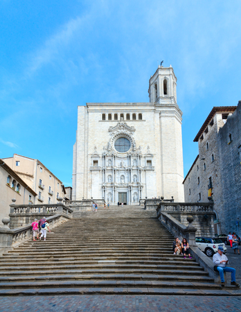 GIRONA, SPAIN - SEPTEMBER 11, 2018: Unknown tourists are on Cathedral Square near famous Gothic Cathedral in historic center of Girona, Spain